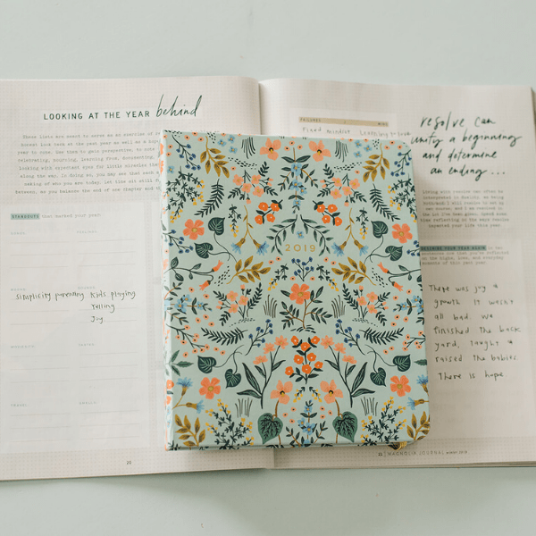 Magnolia Journal winter 2019 issue opened to resolutions page with rifle paper 2019 planner.