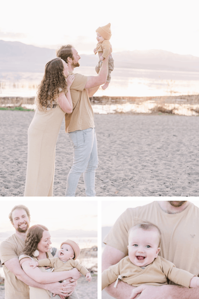 Baby in tan clothes and beanie looks towards the camera as mom and dad play with him in family photography session on Vineyard Beach